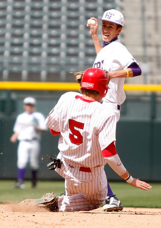 "Holy Family's, Adrian Do,#7, makes the play to get Eaton's, Colton Lind, #5, out at second base during the 5th inning of the game on Saturday, March, 31. 2012. Denver. <br /> <br />  For more photos of the game visit  <a href=""http://www.dailycamera.com"">http://www.dailycamera.com</a><br /> Photo by Derek Broussard"