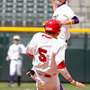 """Holy Family's, Adrian Do,#7, makes the play to get Eaton's, Colton Lind, #5, out at second base during the 5th inning of the game on Saturday, March, 31. 2012. Denver. <br /> <br />  For more photos of the game visit  <a href=""""http://www.dailycamera.com"""">http://www.dailycamera.com</a><br /> Photo by Derek Broussard"""