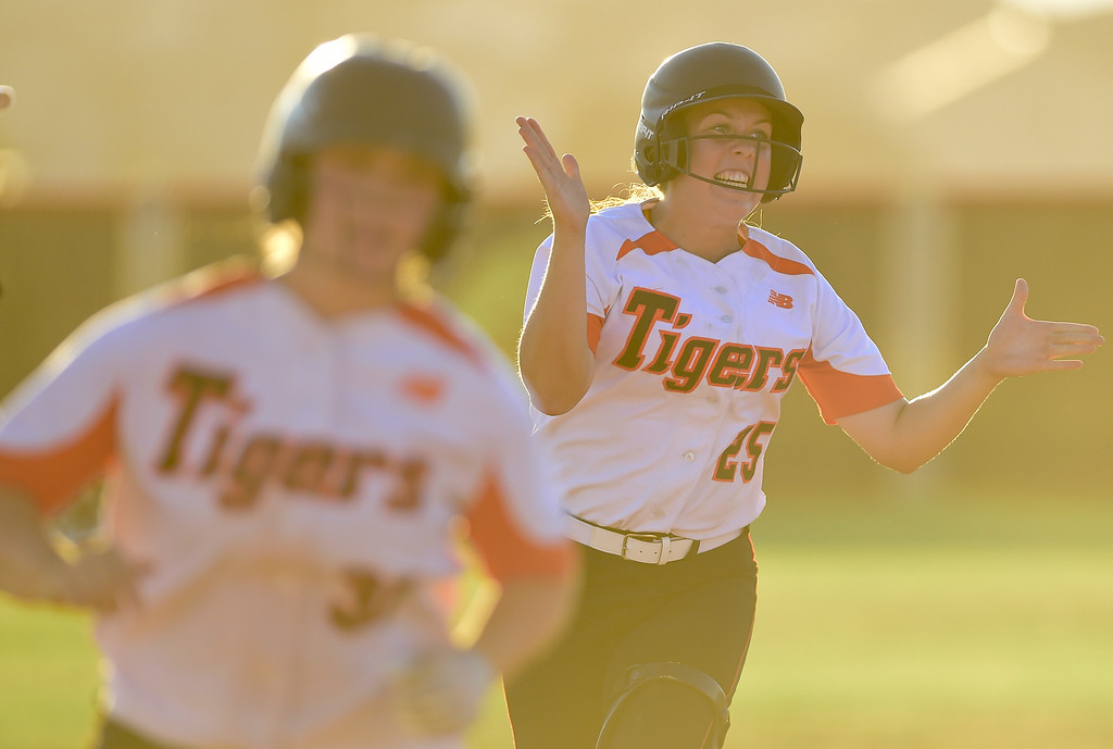 . ERIE, CO - SEPTEMBER 18:Erie High School\'s Maddie Leach (No. 25) celebrates hitting a grand slam against Holy Family High School to tie up the game in Erie on Sept. 18, 2018. Erie defeated Holy Family, 11-9. (Photo by Matthew Jonas/Staff Photographer)