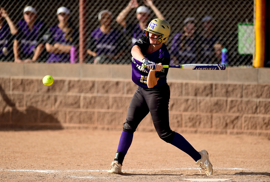 . ERIE, CO - SEPTEMBER 18:Holy Family High School\'s Erin Winters (No. 15) gets a hit against Erie High School in Erie on Sept. 18, 2018. Erie defeated Holy Family, 11-9. (Photo by Matthew Jonas/Staff Photographer)