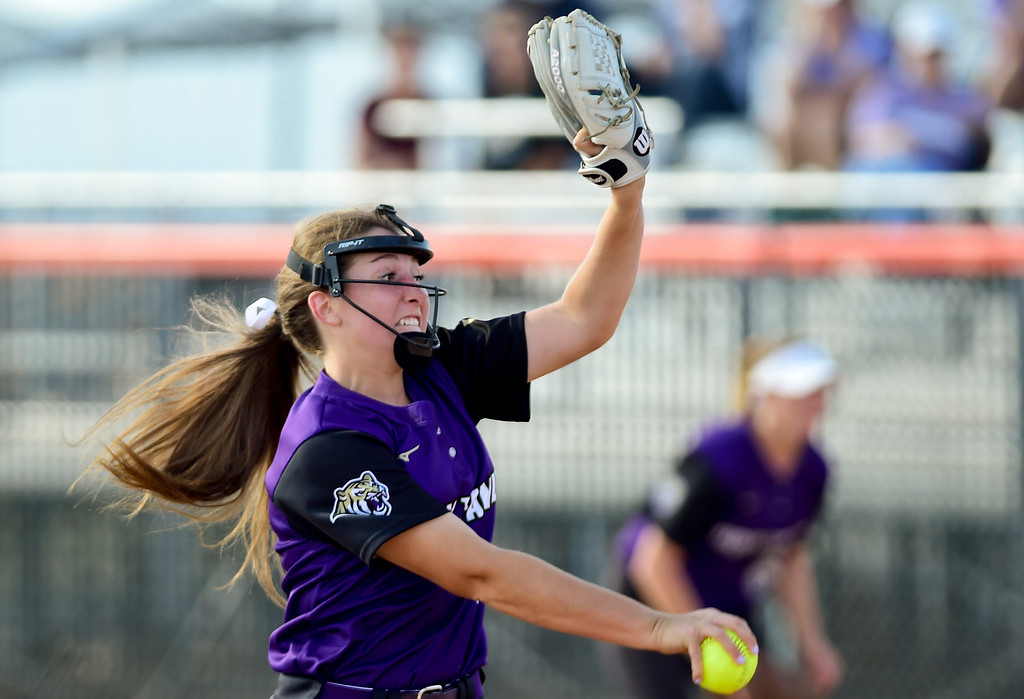 . ERIE, CO - SEPTEMBER 18:Holy Family High School\'s Erin Caviness (No. 5) throws against Erie High School in Erie on Sept. 18, 2018. Erie defeated Holy Family, 11-9. (Photo by Matthew Jonas/Staff Photographer)