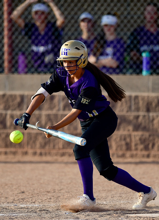. ERIE, CO - SEPTEMBER 18:Holy Family High School\'s Anna Martinez (No. 11) bunts against Erie High School in Erie on Sept. 18, 2018. Erie defeated Holy Family, 11-9. (Photo by Matthew Jonas/Staff Photographer)