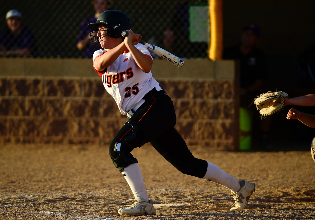 . ERIE, CO - SEPTEMBER 18:Erie High School\'s Maddie Leach (No. 25) hits a grand slam against Holy Family High School to tie up the game in Erie on Sept. 18, 2018. Erie defeated Holy Family, 11-9. (Photo by Matthew Jonas/Staff Photographer)