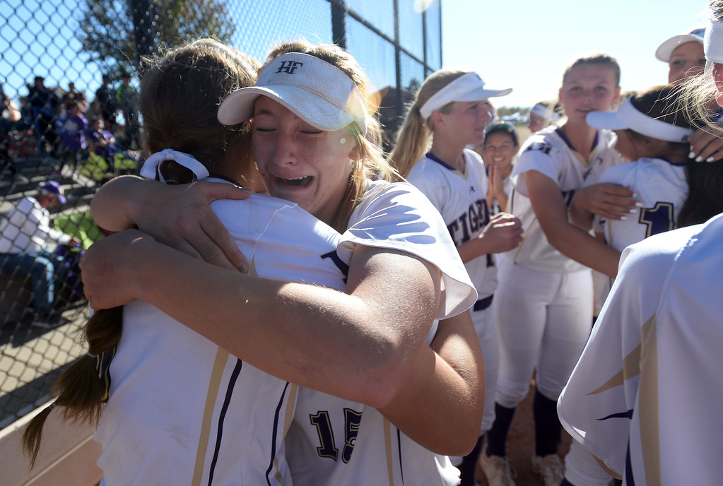 . AURORA, CO - October 20, 2018: Erin Caviness, left, of Holy Family, is hugged by Erin Winters. Holy Family beats Mountain View to win the 4A State Softball Championship in Aurora on Saturday.  (Photo by Cliff Grassmick/Staff Photographer)