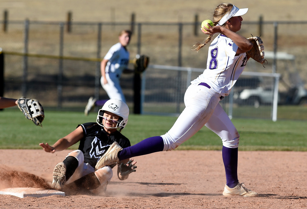 . AURORA, CO - October 20, 2018: Noelle Gardon, right, turns a double play on Mountain View.  Holy Family beats Mountain View to win the 4A State Softball Championship in Aurora on Saturday.  (Photo by Cliff Grassmick/Staff Photographer)