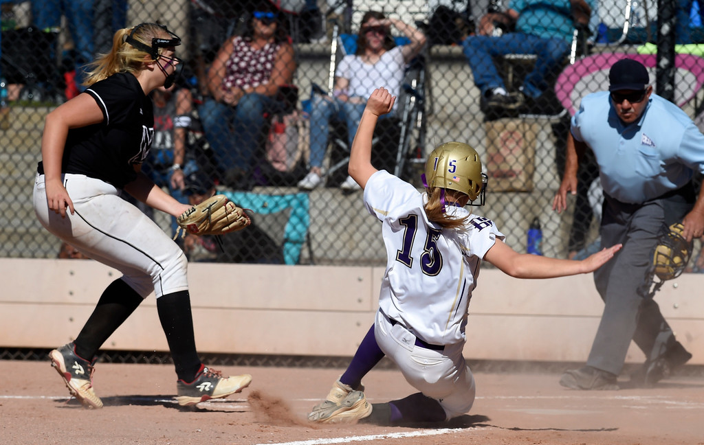 . AURORA, CO - October 20, 2018: Erin Winters, of Holy Family comes home after a wild pitch. Holy Family beats Mountain View to win the 4A State Softball Championship in Aurora on Saturday.  (Photo by Cliff Grassmick/Staff Photographer)