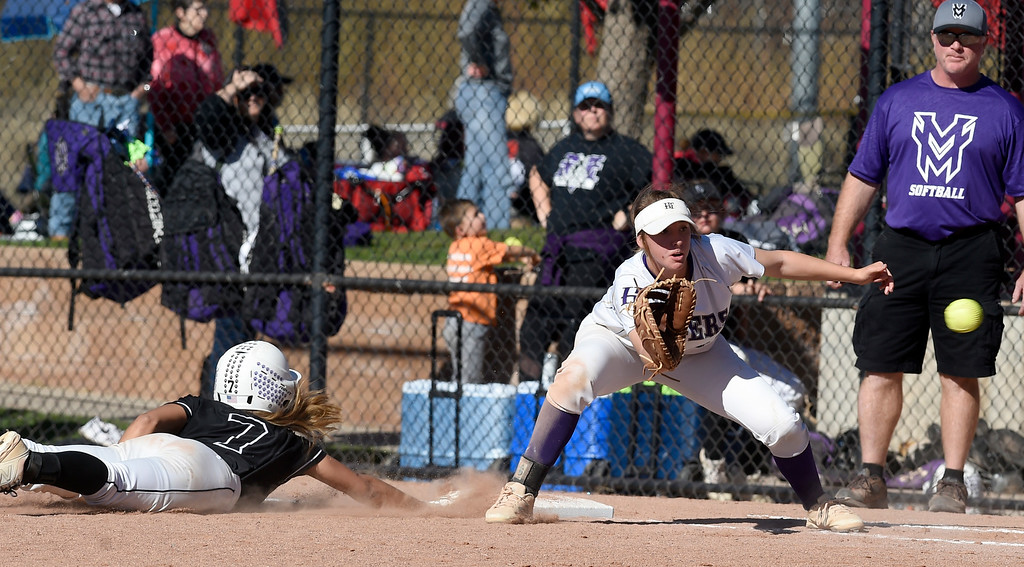 . AURORA, CO - October 20, 2018: Nya Chacon, of Mountain View, gets back to first before the throw to Erin Winters, of Holy Family.  Holy Family beats Mountain View to win the 4A State Softball Championship in Aurora on Saturday.  (Photo by Cliff Grassmick/Staff Photographer)