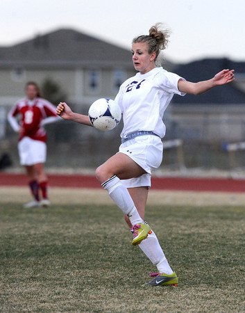 """Holy Family High School's Micaela Blanchard knees the ball on Monday, March 19, during a soccer game against Holy Family High School at Holy Family High School in Broomfield. For more photos of the game go to  <a href=""""http://www.dailycamera.com"""">http://www.dailycamera.com</a><br /> Jeremy Papasso/ Camera"""