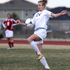 "Holy Family High School's Micaela Blanchard knees the ball on Monday, March 19, during a soccer game against Holy Family High School at Holy Family High School in Broomfield. For more photos of the game go to  <a href=""http://www.dailycamera.com"">http://www.dailycamera.com</a><br /> Jeremy Papasso/ Camera"