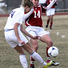 "Holy Family High School's Micaela Blanchard, No. 24, passes the ball past Centaurus High School's Lauren Esler, No. 14, on Monday, March 19, during a soccer game at Holy Family High School in Broomfield. For more photos of the game go to  <a href=""http://www.dailycamera.com"">http://www.dailycamera.com</a><br /> Jeremy Papasso/ Camera"