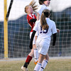 "Holy Family High School's Abby Metzger, heads the ball over Centaurus High School's Morgan Brendefur, back left, on Monday, March 19, during a soccer game at Holy Family High School in Broomfield. For more photos of the game go to  <a href=""http://www.dailycamera.com"">http://www.dailycamera.com</a><br /> Jeremy Papasso/ Camera"