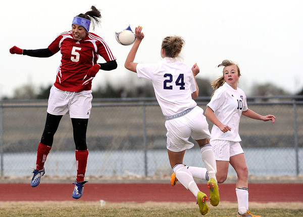"Holy Family High School's Micaela Blanchard, No. 24, and Centaurus High School's Shanlie Anderson, No. 5, try to head the ball on Monday, March 19, during a soccer game at Holy Family High School in Broomfield. For more photos of the game go to  <a href=""http://www.dailycamera.com"">http://www.dailycamera.com</a><br /> Jeremy Papasso/ Camera"