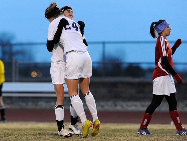 "Holy Family High School's Micaela Blanchard, No. 24, hugs teammate Monica Stokes after scoring a goal on Monday, March 19, during a soccer game against Holy Family High School at Holy Family High School in Broomfield. For more photos of the game go to  <a href=""http://www.dailycamera.com"">http://www.dailycamera.com</a><br /> Jeremy Papasso/ Camera"