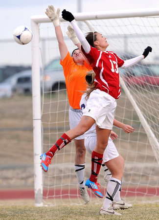 "Holy Family High School goalkeeper Olivia Quinn, left, goes for the block against Centaurus High School's Midori Patterson on Monday, March 19, during a soccer game at Holy Family High School in Broomfield. For more photos of the game go to  <a href=""http://www.dailycamera.com"">http://www.dailycamera.com</a><br /> Jeremy Papasso/ Camera"