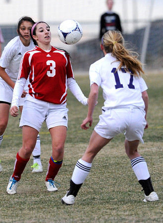 "Centaurus High School's Danelle Dondelinger stops a pass in front of Holy Family's Monica Stokes on Monday, March 19, during a soccer game at Holy Family High School in Broomfield. For more photos of the game go to  <a href=""http://www.dailycamera.com"">http://www.dailycamera.com</a><br /> Jeremy Papasso/ Camera"