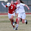 "Holy Family High School's Abby Metzger, No. 20, fights for the ball with Centaurus High School's Danelle Dondelinger on Monday, March 19, during a soccer game at Holy Family High School in Broomfield. For more photos of the game go to  <a href=""http://www.dailycamera.com"">http://www.dailycamera.com</a><br /> Jeremy Papasso/ Camera"