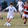 "Holy Family High School's Kendall Russell, No. 11, dribbles the ball upfield past Centaurus High School's Hayley Vero, No. 8, on Monday, March 19, during a soccer game at Holy Family High School in Broomfield. For more photos of the game go to  <a href=""http://www.dailycamera.com"">http://www.dailycamera.com</a><br /> Jeremy Papasso/ Camera"