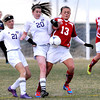 "Holy Family High School's Cassidy Hemp, No. 21, and Abby Metzger, No. 20, fight for the ball with Centaurus High School's Midori Patterson on Monday, March 19, during a soccer game at Holy Family High School in Broomfield. For more photos of the game go to  <a href=""http://www.dailycamera.com"">http://www.dailycamera.com</a><br /> Jeremy Papasso/ Camera"