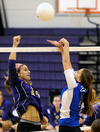 "Holy Family High School's Blayke Hranicka, left, gets her kill rejected by Jordan Powley during a volleyball match against Peak to Peak High School on Thursday, Oct. 4, at Holy Family High School in Broomfield. For more photos of the match go to  <a href=""http://www.dailycamera.com"">http://www.dailycamera.com</a><br /> Jeremy Papasso/ Camera"