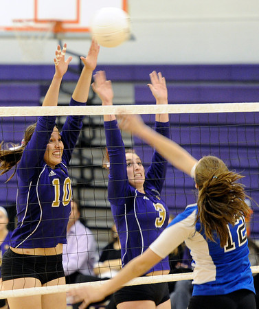 "Holy Family High School's Claudia Pena, No. 10, and Tori Mosko try to block a kill from Alison Hankey during a volleyball match against Peak to Peak High School on Thursday, Oct. 4, at Holy Family High School in Broomfield. For more photos of the match go to  <a href=""http://www.dailycamera.com"">http://www.dailycamera.com</a><br /> Jeremy Papasso/ Camera"
