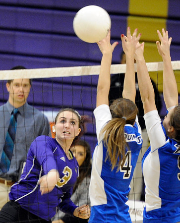 """Holy Family High School's Tori Mosko, left, goes for a kill over Alison Hockstad, No. 4, during a volleyball match against Peak to Peak High School on Thursday, Oct. 4, at Holy Family High School in Broomfield. For more photos of the match go to  <a href=""""http://www.dailycamera.com"""">http://www.dailycamera.com</a><br /> Jeremy Papasso/ Camera"""