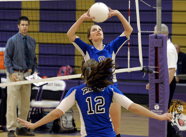 """Peak to Peak High School's Jordan Powley sets up teammate Alison Hankey for a kill during a volleyball match against Holy Family High School on Thursday, Oct. 4, at Holy Family High School in Broomfield. For more photos of the match go to  <a href=""""http://www.dailycamera.com"""">http://www.dailycamera.com</a><br /> Jeremy Papasso/ Camera"""