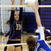 "Holy Family High School's Claudia Pena tries to block a kill from Amy Haberthier during a volleyball match against Peak to Peak High School on Thursday, Oct. 4, at Holy Family High School in Broomfield. For more photos of the match go to  <a href=""http://www.dailycamera.com"">http://www.dailycamera.com</a><br /> Jeremy Papasso/ Camera"