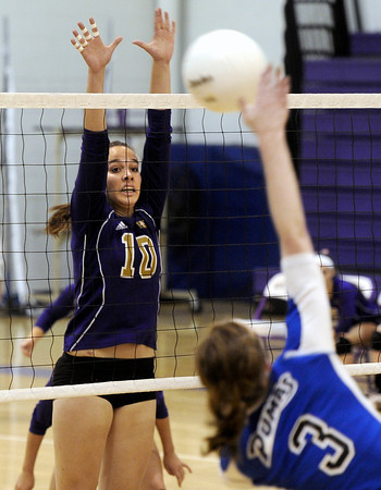 """Holy Family High School's Claudia Pena tries to block a kill from Amy Haberthier during a volleyball match against Peak to Peak High School on Thursday, Oct. 4, at Holy Family High School in Broomfield. For more photos of the match go to  <a href=""""http://www.dailycamera.com"""">http://www.dailycamera.com</a><br /> Jeremy Papasso/ Camera"""