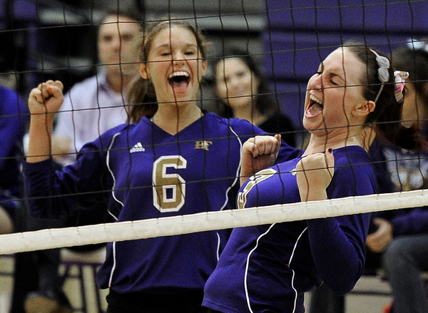 "Holy Family High School's Amy Golter, left, and Tori Mosko celebrate a point during a volleyball match against Peak to Peak High School on Thursday, Oct. 4, at Holy Family High School in Broomfield. For more photos of the match go to  <a href=""http://www.dailycamera.com"">http://www.dailycamera.com</a><br /> Jeremy Papasso/ Camera"