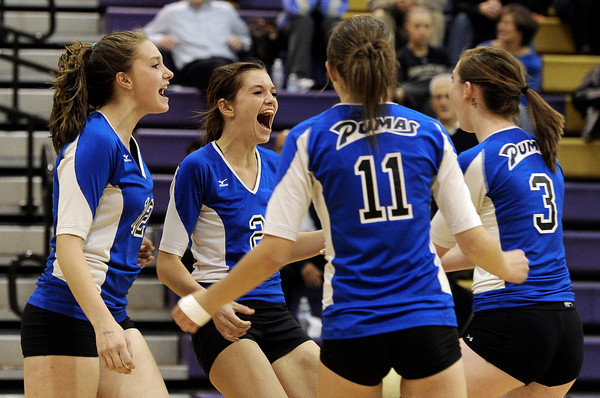 """Peak to Peak High School's Alison Hankey, left, Jordyn Saindon, Kaelyn Powers and Amy Haberthier celebrate a point during a volleyball match against Holy Family High School on Thursday, Oct. 4, at Holy Family High School in Broomfield. For more photos of the match go to  <a href=""""http://www.dailycamera.com"""">http://www.dailycamera.com</a><br /> Jeremy Papasso/ Camera"""