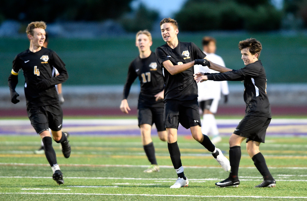 . BROOMFIELD, CO - OCTOBER 8, 2018: Holy Family High School\'s Cody Chavers, center, is congratulated on a goal during a game against Skyline on Monday in Broomfield. More photos: BoCoPreps.com (Photo by Jeremy Papasso/Staff Photographer)