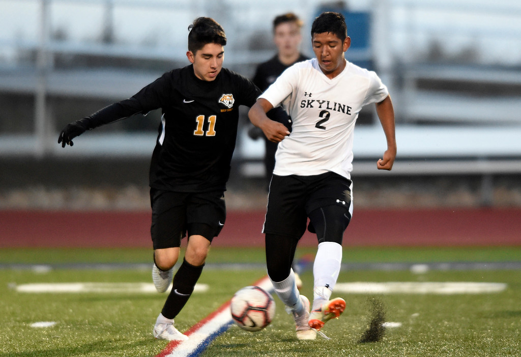 . BROOMFIELD, CO - OCTOBER 8, 2018: Skyline High School\'s Salvador Medrano moves the ball past Jimmy Sines during a game against Holy Family on Monday in Broomfield. More photos: BoCoPreps.com (Photo by Jeremy Papasso/Staff Photographer)