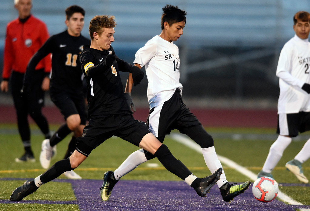 . BROOMFIELD, CO - OCTOBER 8, 2018: Holy Family High School\'s Jake Hulquest, left, fights for the ball with Gabriel Sosa during a game against Skyline on Monday in Broomfield. More photos: BoCoPreps.com (Photo by Jeremy Papasso/Staff Photographer)