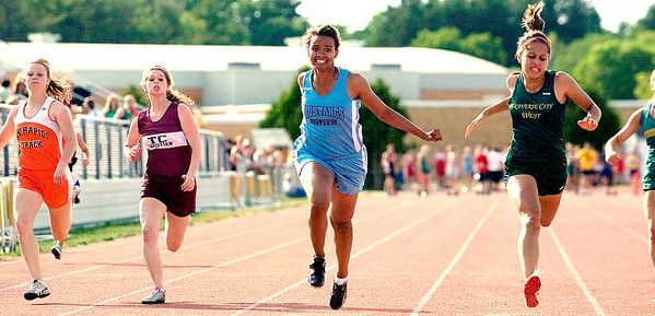 Record-Eagle/Jan-Michael Stump<br /> Grand Traverse Academy's Rachel Zeppa edges TC West's Savannah Stuart-Dahl, right, in the 100-meter dash at the Record-Eagle Honor Roll Meet.
