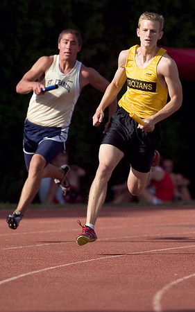 Record-Eagle/Jan-Michael Stump<br /> Anchor runners Jack Stevens of Traverse City Central (first place, right) and Traverse City St. Franciss' Ben Swan (second, left) round the final curve in the 800 meter relay in the Record- Eagle Honor Roll Meet.