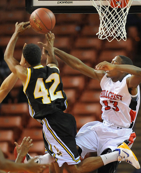 Hillcrest's Ki-Jana Madden defends against Irmo's Heyward Goodson. Irmo beat Hillcrest 63-49 to advance to Friday's Class  AAAA State Championship game against Goose Creek at the Colonial Life Center in Columbia. <br /> The Hillcrest Rams and the Irmo Yellow Jackets battled in the Upper State Basketball Championships at the Bi-Lo Center in Greenville.<br /> GWINN DAVIS PHOTOS<br /> gwinndavisphotos.com (website)<br /> (864) 915-0411 (cell)<br /> gwinndavis@gmail.com  (e-mail) <br /> Gwinn Davis (FaceBook)