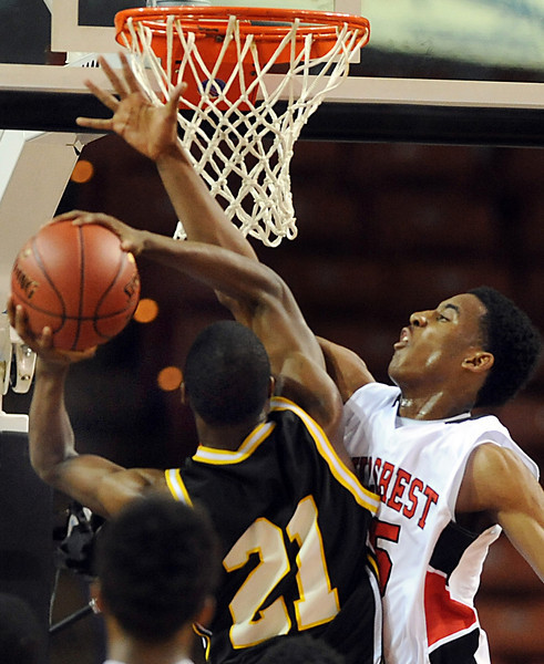 The Hillcrest Rams and the Irmo Yellow Jackets battled in the Upper State Basketball Championships at the Bi-Lo Center in Greenville.<br /> GWINN DAVIS PHOTOS<br /> gwinndavisphotos.com (website)<br /> (864) 915-0411 (cell)<br /> gwinndavis@gmail.com  (e-mail) <br /> Gwinn Davis (FaceBook)