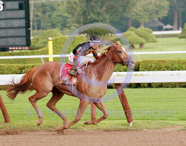 Ginger Punch ridden by Rafael Bejarano wins the 55th Running of The Go For Wand Stakes at Saratoga Race Course in a driving rain storm.