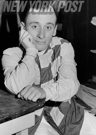 Jockey Pete Anderson poses in his horse racing attire. 1957