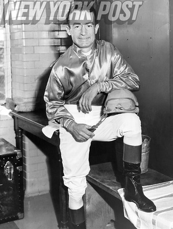 Ted Atkinson, famed jockey strikes a pose. 1957