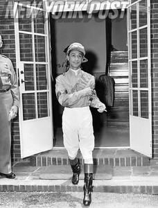 Eddie Arcaro after 1957 horse race in New York.