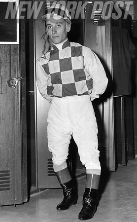 Jockey Pete Anderson poses in the locker room. 1957