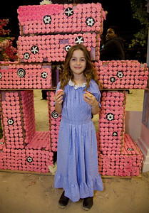 Young Katie Hirsch enjoys a cupcake. The costumed Gambler's Choice featured the joker fence made out of cupcakes courtesy of new sponsor and TLC reality-show Georgetown Cupcakes. After the competition, attendees of the event were invited to eat the prop.