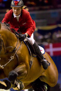 The Washington International Horse Show attracted riders from all over the world.  Ljubov Kochetova from Russia rides her horse Royce over a jump in the $100,000 Presdents Cup on October 29.