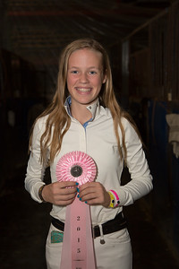 Haley Redifer shows her ribbon for placing in the Children's Jumper Championship