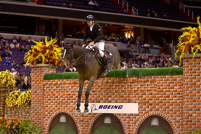 Great Britain's Nick Skelton guided his horse Unique over a 7 foot wall to win the $25,000 Puissance at the Washington International Horse Show on Friday, October 28 at the Verizon Center.