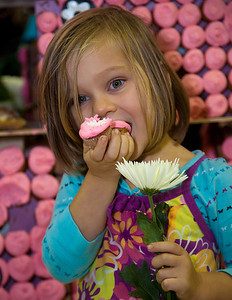 Ella Sabine Hatcher enjoys a cupcake. The costumed Gambler's Choice featured the joker fence made out of cupcakes courtesy of new sponsor and TLC reality-show Georgetown Cupcakes. After the competition, attendees of the event were invited to eat the prop.
