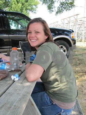 Leah Hovey enjoyed the shade between watching the barrel race events.