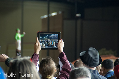 A fan in the crowd films the winner circle ceremony with her iPad after the running of the 5th running of the Charles Town Classic