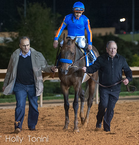 Owners Joe Torre and Bernie Schiappa lead their horse Game On Dude with jockey Mike Smith aboard after he won the Charles Town Classic